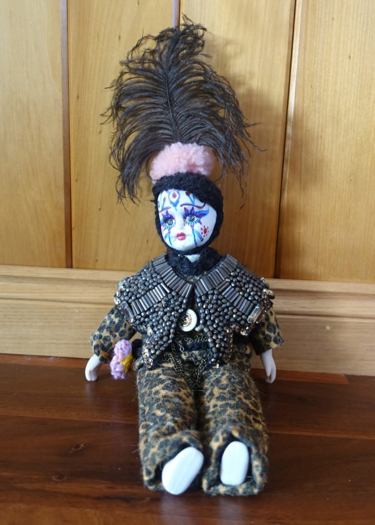 doll with ostrich feather